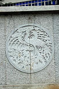 石墙雕刻火凤凰图案