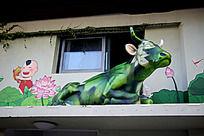 手绘荷花牧牛童图和牛雕塑
