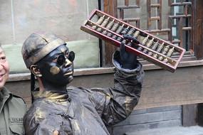 成都锦里拿算盘戴墨镜的人铜像雕塑
