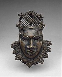 青铜巫师人头人物雕像