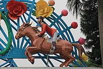 骑着马匹的卡通人物雕塑