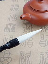 茶壶壶嘴和毛笔创意图片