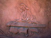 弹古琴的女子雕刻