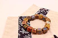 民族风布袋上的火山石花釉方形圆珠瓷珠手链