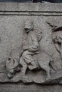 骑牛石质浮雕