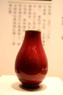 清代郎窑红柚带盖瓷瓶正面