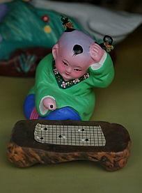 泥人张下棋的小男孩