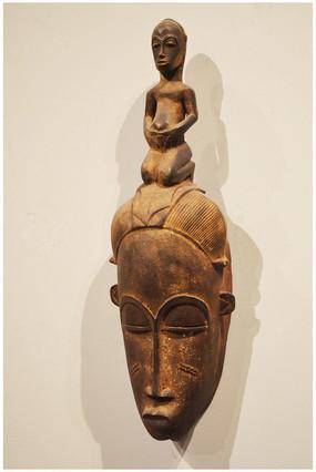 头顶人物木雕面具