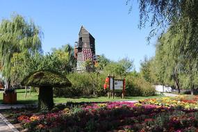 鲜花垂柳瞭望木塔