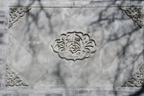 兰花纹壁照石刻