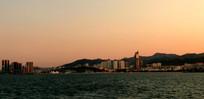 夕阳滨海建筑图片