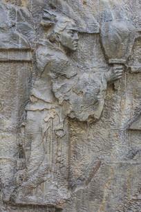 壁雕手拿羽扇的古代女人