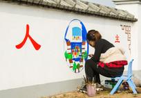 围墙绘画女孩