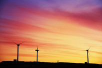 戈壁风力发电日出霞光剪影