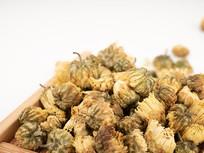 木盘中的胎菊茶花