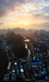 航拍桂林市内山峦日落