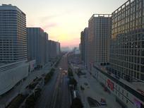 航拍城市早晨朝阳