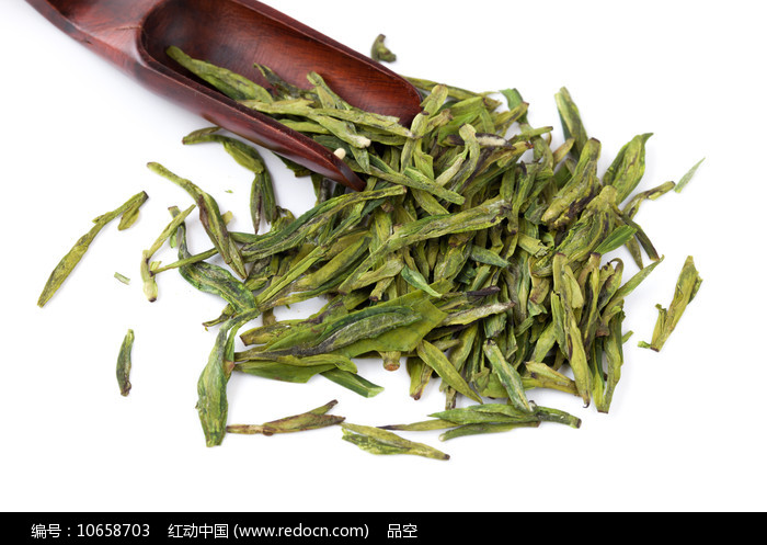 西湖龙井茶叶茶匙白背景摄影图图片
