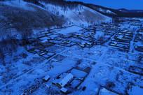 航拍林区雪色山村夜景