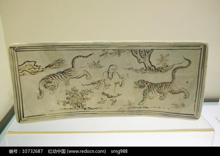 磁州窑降虎故事瓷枕头元代图片
