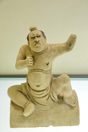 素胎蹲坐力士瓷像