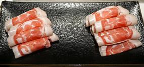 一盘四川火锅配菜羊肉卷