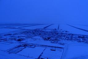 航拍雪域雪原村庄雪夜