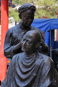 传统手艺理发铜雕像