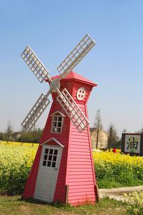 菜花田里的风车