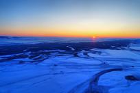 航拍雪域雪原日落