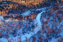 航拍雪原雪河森林夕照