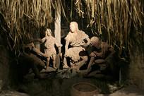 原始人草棚内生活场景雕塑