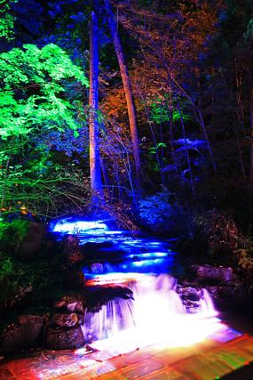 长白山树林溪水灯光夜景