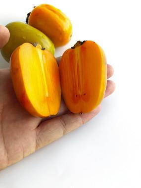 白底切开柿子